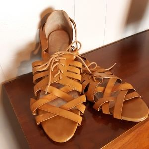 Restricted strappy leather sandals